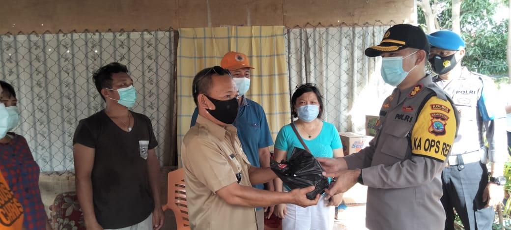 Peduli Korban Bencana Alam, Polres Minsel Serahkan Bantuan di Tumpaan