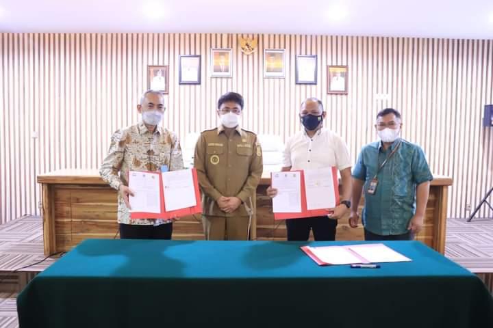Bersinergi Bangun Kota Manado, Wali Kota Andrei Teken PKS dengan Kementerian PUPR dan PT SMF